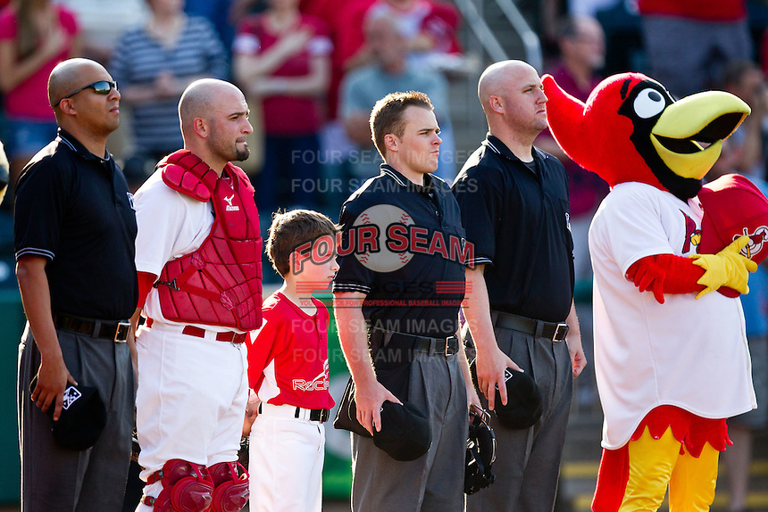 Nick Derba (18) of the Springfield Cardinals stands with a young fan and the umpires during the National Anthem prior to a game against the Arkansas Travelers at Hammons Field on May 5, 2012 in Springfield, Missouri. (David Welker/Four Seam Images)