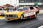 A nostalgia funny car makes a run at the O'Reilly Auto Parts Spring Nationals Finals at the Royal Purple Raceway in Baytown,Texas.