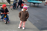 Day Care Center 2-3 year olds outside on playground girl crying separation boy on trike observiing her