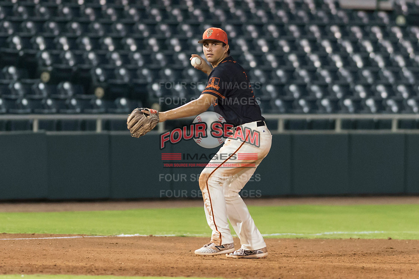 AZL Giants Black third baseman Sean Roby (5) throws to first base during an Arizona League game against the AZL Rangers at Scottsdale Stadium on August 4, 2018 in Scottsdale, Arizona. The AZL Giants Black defeated the AZL Rangers by a score of 6-3 in the second game of a doubleheader. (Zachary Lucy/Four Seam Images)