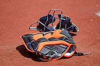 Catchers gear sits on the ground prior to the start of the game as the Salt Lake Bees faced the Fresno Grizzlies in Pacific Coast League action at Smith's Ballpark on June 14, 2015 in Salt Lake City, Utah.  (Stephen Smith/Four Seam Images)