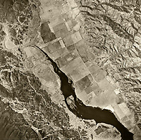 historical aerial photograph the Putah River and agricultural valley at the northern end of what is now Lake Berryessa, Napa County, California, 1957