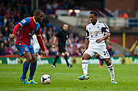 Sun 22 September 2013<br /> <br /> Pictured: Danny Gabbidon of Crystal Palace and Jonathan de Guzman  of Swansea<br /> <br /> Re: Barclays Premier League Crystal Palace FC  v Swansea City FC  at Selhurst Park, London