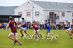 Jack Daly for St Marys shows his strength as he pulls away from Dromids Aodhán Súilleabháin & Michael ÓCorráin for this scoring opportunity.
