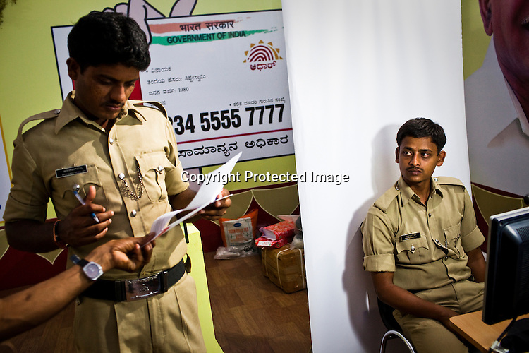 Local policemen wait to have their data stored during national identity enrollment in Mysore city in Karnataka, India. Photograph: Sanjit Das/Panos