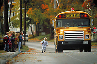 Children at school bus stop, Belfast Maine