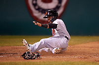 Visalia Rawhide shortstop Jancarlos Cintron (3) slides safely across home plate during a California League game against the San Jose Giants on April 12, 2019 at San Jose Municipal Stadium in San Jose, California. Visalia defeated San Jose 6-2. (Zachary Lucy/Four Seam Images)