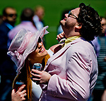 LEXINGTON, KENTUCKY - APRIL 08: A woman fixes her boyfriend's bow tie on Blue Grass Stakes Day at Keeneland Race Course on April 8, 2017 in Lexington, Kentucky. (Photo by Scott Serio/Eclipse Sportswire/Getty Images)