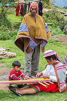 Peru, Urubamba Valley, Quechua Village of Misminay.  Father, Mother, and Son.
