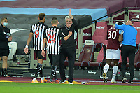 Miguel Almiron of Newcastle United and Joe linton of Newcastle United and Newcastle United Manager Steve Bruce during West Ham United vs Newcastle United, Premier League Football at The London Stadium on 12th September 2020