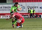 Scarlets flanker Aaron Shingler tackles Munster lock Billy Holland.<br /> Guiness Pro12<br /> Scarlets v Munster<br /> 21.02.15<br /> ©Steve Pope -SPORTINGWALES