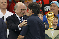 FIFA President Sepp Blatter shakes hands with Germany manager Joachim Low near the World Cup trophy