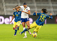 ORLANDO, FL - JANUARY 18: Lynn Williams #6 of the USWNT nutmegs Orianica Velasquez #15 of Colombia during a game between Colombia and USWNT at Exploria Stadium on January 18, 2021 in Orlando, Florida.