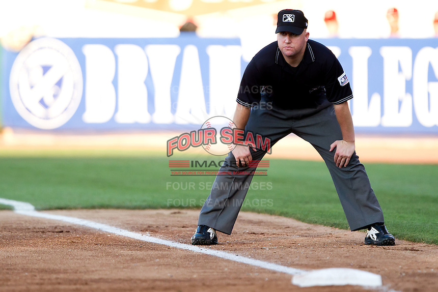 First base umpire Ryan Blakney watches the pitcher's movements during a game between the Tulsa Drillers and the Springfield Cardinals at Hammons Field on July 19, 2011 in Springfield, Missouri. Tulsa defeated Springfield 17-11. (David Welker / Four Seam Images)