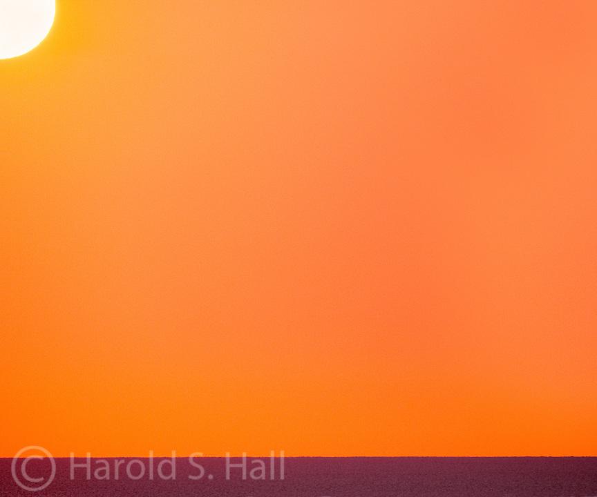 An orange sunrise over Lake Michigan, Chicago, Illinois.