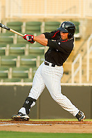 Drew Lee #11 of the Kannapolis Intimidators follows through on his swing against the Delmarva Shorebirds at Fieldcrest Cannon Stadium on May 23, 2011 in Kannapolis, North Carolina.   Photo by Brian Westerholt / Four Seam Images