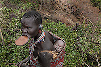 Village just outside Tulgit named Bargoba.  Many women in this village have lip plates... even young women... the more remote villages are the places for this...Contacts:.Steve Turner... steveturner@originsafari.info.+ 254 722 707521..Robel Pedros Local guide for Surma.+ 251 911 423112.Daniel Tesfaye  +251 912 029726