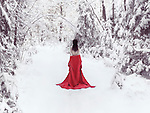 Beautiful half nude woman with bare back in red kimono walking away into a snowy winter scenery Image © MaximImages, License at https://www.maximimages.com