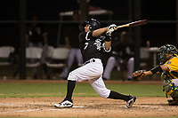 AZL White Sox second baseman Nick Madrigal (7) follows through on his swing during an Arizona League game against the AZL Athletics at Camelback Ranch on July 15, 2018 in Glendale, Arizona. The AZL White Sox defeated the AZL Athletics 2-1. (Zachary Lucy/Four Seam Images)