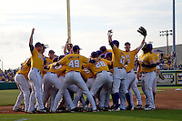 LSU Tiger baseball team huddle at Alex Box Stadium before the NCAA Super Regional baseball game on June 10, 2012 in Baton Rouge, Louisiana.(Andrew Woolley/Four Seam Images)