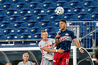 FOXBOROUGH, MA - AUGUST 29: Patrick Seagrist #7 of New York Red Bulls and Brandon Bye #15 of New England Revolution battle for head ball during a game between New York Red Bulls and New England Revolution at Gillette Stadium on August 29, 2020 in Foxborough, Massachusetts.