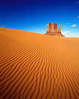 USA, Arizona. Monument Valley Navajo Tribal Park. Sand dunes and view of East Mitten
