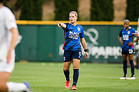 TACOMA, WA - JULY 31: Eugenie Le Sommer #9 of the OL Reign directs her teammates during a game between Racing Louisville FC and OL Reign at Cheney Stadium on July 31, 2021 in Tacoma, Washington.