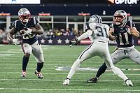FOXBOROUGH, MA - NOVEMBER 24: Dallas Cowboys Cornerback Byron Jones #31 prepares to tackle New England Patriots Runningback Sony Michel #26 during a game between Dallas Cowboys and New England Patriots at Gillettes on November 24, 2019 in Foxborough, Massachusetts.