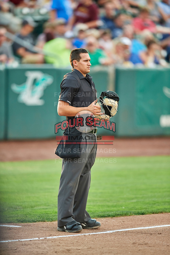 Umpire John Perez handles the calls behind the plate during the game between the Ogden Raptors and the Grand Junction Rockies at Lindquist Field on July 25, 2018 in Ogden, Utah. The Rockies defeated the Raptors 4-0. (Stephen Smith/Four Seam Images)