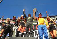 Apr 16, 2011; Surprise, AZ USA; LOORRS driver Rick Huseman (center) on the podium with Kyle Leduc (left) and Adrian Cenni following round 3 at Speedworld Off Road Park. Mandatory Credit: Mark J. Rebilas-.