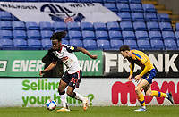 Bolton Wanderers' Peter Kioso breaks away from  Mansfield Town's Corey O'Keeffe (right) <br /> <br /> Photographer Andrew Kearns/CameraSport<br /> <br /> The EFL Sky Bet League Two - Bolton Wanderers v Mansfield Town - Tuesday 3rd November 2020 - University of Bolton Stadium - Bolton<br /> <br /> World Copyright © 2020 CameraSport. All rights reserved. 43 Linden Ave. Countesthorpe. Leicester. England. LE8 5PG - Tel: +44 (0) 116 277 4147 - admin@camerasport.com - www.camerasport.com