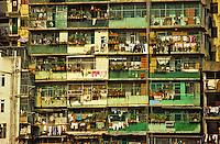 Hong Kong, China. Crowded tenement block of apartments with balconies.  Mon Kok. Kowloon.