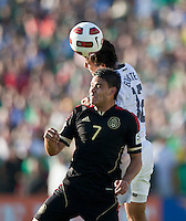 PASADENA, CA – June 25, 2011: Mexico player Pablo Barrera (7) and USA Jonathan Bornstein (12) during the Gold Cup Final match between USA and Mexico at the Rose Bowl in Pasadena, California. Final score USA 2 and Mexico 4.