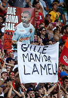 "Calcio: allenamento a porte aperte ""Open Day"" per la presentazione della Roma, a Roma, stadio Olimpico, 21 agosto 2013.<br /> AS Roma fans hold a banner reading ""Hands off Lamela"", referring to AS Roma forward Erik Lamela, of Argentina, during the AS Roma football club's Open Day training session at Rome's Olympic stadium, 21 August 2013.<br /> UPDATE IMAGES PRESS/Riccardo De Luca"