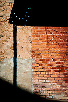 """A fine art western abstract of a brick building in the California village of Hornitos.  The name means """"little ovens"""" in Spanish.  The town predates the California gold rush era.  The village gained notoriety during the gold rush era as a hideout for Joaquin Murrietta, active as a bandit in the 1850's.  The name was derived from the community's old Mexican tombstones that were built in the shape of little square bake ovens.  Hornitos is registered as California Historical Landmark #333."""