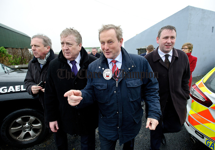 Jim Mc Mahon, Munster organiser for Fine Gael, Pat Breen, TD,  Enda Kenny, Taoiseach and Joe Carey, TD leave a house after calling in during the visit of the Taoiseach to Loop Head to launch the Fine Gael tourism initiative. Photograph by John Kelly.