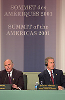 April 22,  2001, Montreal, Quebec, Canada<br />  US president George W, Bush (R)  listen while <br /> Argentina President Fernando De La Rua (L) speak at the closing press conference of the Summit of the Americas , April 22, 2001 in Quebec City, CANADA.<br /> <br /> De la Rua decided to impose martial law this week (dec 20, 2001) after riots and looting in maby cities