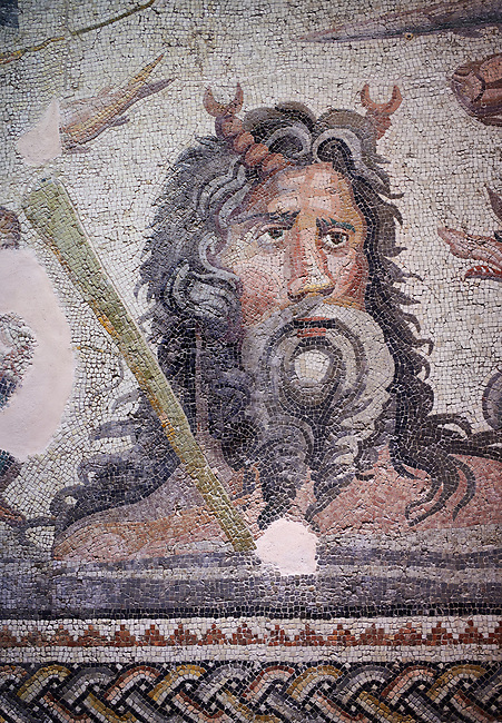Roman Mosaic - close up river god Oceanos The Oceanos & Tethys Mosaic, fom The House of Oceanos, Zeugma.  2nd - 3rd century AD. Zeugma Mosaic Museum, Gaziantep, Turkey.<br /> <br /> The Oceanos and Tethys Mosaic is the floor mosaic of the shallow pool of the House of Oceanos. In this mosaic, which belongs to the Early Roman Empire Period, Oceanos, the river god who is the origin of life, and his wife Tethys are represented. At the middle of the mosaic which is surrounded by a geometric triple tress borders there are Oceanos and his wife Tethys. Around them there are Eros figures riding various species of fish and dolphins symbolising the abundance of the sea. The most represented attributes of Oceanos are snake and fish.<br /> <br />  in the mosaic, Oceanos is seen with chelas. Those chelas are among his most characteristic attributes. Though the tail of an eel is represented as his feet in the figures on ceramics, within the scope of the art of mosaic he is represented as a bust and only with the chelas on his head such as this one. His wife Tethys is right by his side and represented with wings upon her forehead. Between them, there is the dragon called Cetos which is a mythological sea creature. As is seen in the coins of Zeugma, the Euphrates River is expressed as a dragon. Besides these two figures, on the top-right of the mosaic, there is a young male figure which is thought to be Pan, the patron of fishermen and shepherds. The fact that Eros figures and Pan which are the side figures are located outward implies that the pool is built to allow walking around. <br /> <br /> The expression of the Oceanos as not an ocean but a river surrounding the world: By that the water, which vapours with the heat of the sun and then gives life to the nature by becoming rain, and which after being used by the nature reaches again the sea via the rivers is expressed. The water becomes aware of itself and its function by that cycle. This phenomenon is represented in the mosaic 