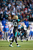 Jacksonville Jaguars Telvin Smith (50) celebrates after Jalen Ramsey (not shown) intercepts a pass to seal the victory during an NFL Wild-Card football game against the Buffalo Bills, Sunday, January 7, 2018, in Jacksonville, Fla.  (Mike Janes Photography)