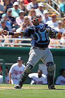 Tampa Bay Rays catcher Jose Molina #28 throws to first during a spring training game against the Minnesota Twins at Hammond Stadium on March 26, 2012 in Fort Myers, Florida.  The Rays defeated the Twins 10-4.  (Mike Janes/Four Seam Images)