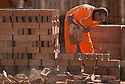 01/10/15<br /> <br /> A man checks and stacks some of the 18,000 bricks he is due to move today.<br /> <br /> ***Full story here:  http://www.fstoppress.com/articles/london-bricks/  ***<br /> <br /> Triathletes have recently coined the term 'brick workout' to describe their gruelling training regime when running, following tough sessions on their bicycles.<br /> <br /> But one group of workers have been using their very own 'brick workout' for decades, without the need for lycra, personal trainers or lightweight bicycles.<br /> <br /> These men, 21 on every shift, each pick-up, inspect, and re-stack 18,000 London Bricks every day.<br /> <br /> One brick weighs 2 kg – so each man lifts the equivalent of almost 40 tons every day at the brick works, near Peterborough, where 2.8 million bricks are made each week.<br /> <br /> All Rights Reserved: F Stop Press Ltd. +44(0)1335 418365   www.fstoppress.com.