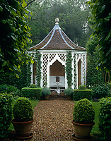 A gravel path leads through the garden to a gazebo with a pepper-pot roof