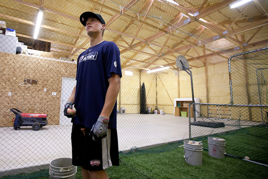 Brandon Nimmo stands inside his family's batting cage during a tour on Tuesday, June 21, 2011, in Cheyenne, Wyo. (Photo by James Brosher)