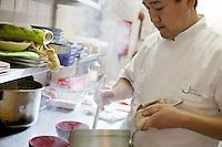 Chef Jiro Kondo preparing dishes at the Saison restaurant, Rue Gubernatis, Nice, France 30 November 2011