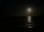 A full mpoon rises over the Atlantic Ocean