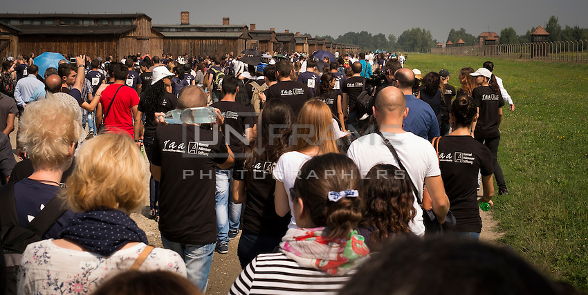70th anniversary of Roma genocide: a group of Roma and non-Roma people walking towards the memorial service.
