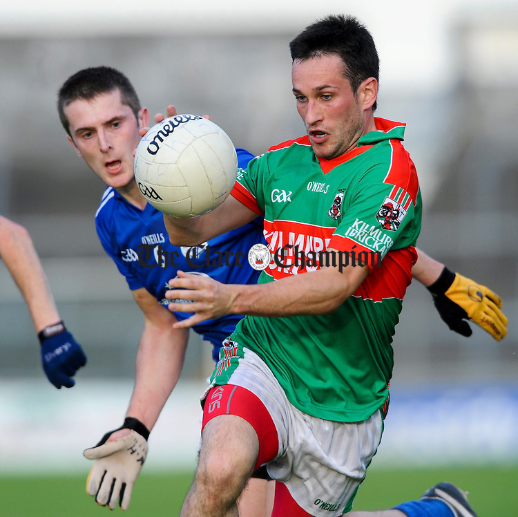 Michael Hawes of Cratloe in action against Michael O Dwyer of Kilmurry Ibrickane during their senior championship game at Cusack park. Photograph by John Kelly.