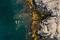 Two swimmers enjoy summer swim in Kattegat sea along Kuststigen trail - Bohus Malmön, West Sweden, Sweden - Västsverige, Sverige