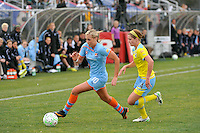Allie Long (10) of Sky Blue FC is chased by Sinead Farrelly (14) of the Philadelphia Independence. The Philadelphia Independence and Sky Blue FC played to a 2-2 tie during a Women's Professional Soccer (WPS) match at Yurcak Field in Piscataway, NJ, on April 10, 2011.