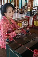 Yogyakarta, Java, Indonesia.  Woman Playing Xylophone.